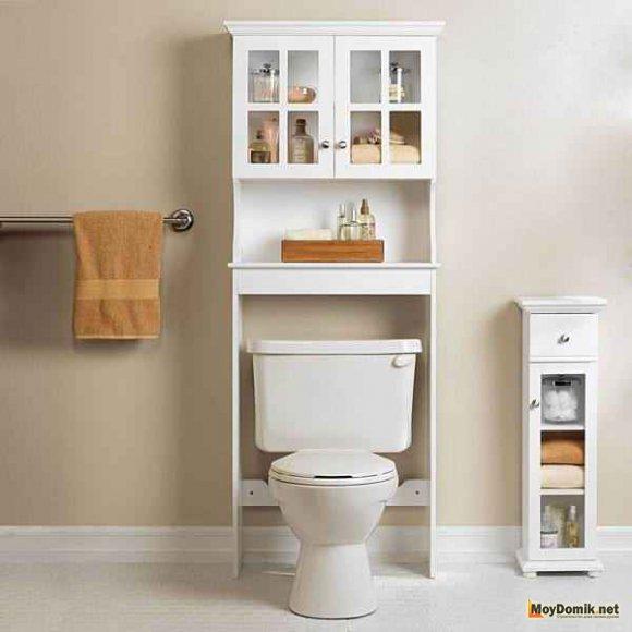 Шкаф за унитазом в интерьере туалета