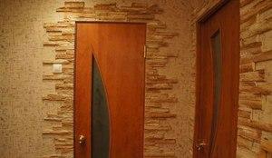 Отделки камнем вокруг дверей
