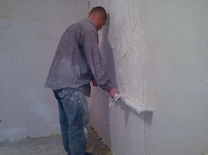Как штукатурить стены из кирпича