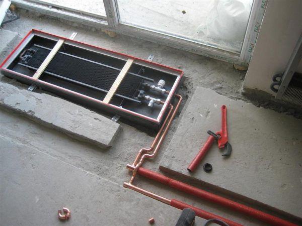 Установка внутрипольного конвектора
